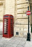 Cabina britannica di rosso del telefono Immagine Stock