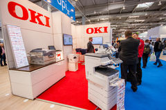 Cabina de la compañía de OKI en el CeBIT Imágenes de archivo libres de regalías