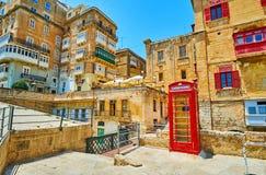 Cabina de teléfono del vintage, La Valeta, Malta fotos de archivo