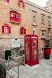 Cabina de teléfonos roja del vintage imagen de archivo