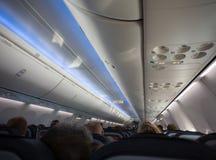 Cabina del jet por completo de pasajeros Foto de archivo libre de regalías