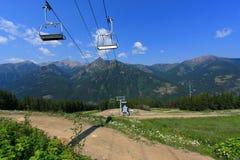 Cabina di funivia della montagna (gondola) Fotografia Stock