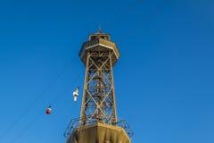 Cabina di funivia della torre di Torre Jaume nel porto di Barcellona Fotografia Stock Libera da Diritti