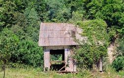 Cabina di legno abbandonata Immagine Stock