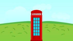 Cabina di telefono nel campo Immagine Stock