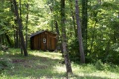 Cabina nella foresta fotografia stock