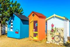 Cabinas de la playa en la isla de Oleron imágenes de archivo libres de regalías