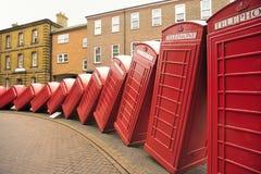 Cabinas de teléfonos que caen, camino viejo de Londres Imagen de archivo libre de regalías