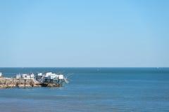Cabinas del pescador en la costa Imágenes de archivo libres de regalías