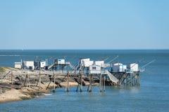 Cabinas del pescador en la costa Fotos de archivo libres de regalías