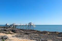 Cabinas del pescador en la costa Imagen de archivo