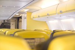 Cabine. Inside a airplane cabine with yellow seats Stock Images