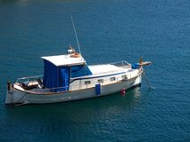 Cabine boat anchoring. In deep blue cal,m sea Royalty Free Stock Photography