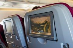 Cabine com os povos a bordo de olhar monitores do LCD Fotos de Stock Royalty Free