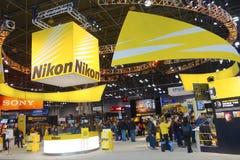 Cabine de Nikon na foto 2014 mais a expo internacional em Javits Convention Center em New York Foto de Stock