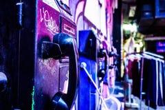 Cabine de téléphone de Grafittied Photographie stock