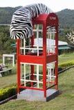 Cabine de telefone formada Imagem de Stock