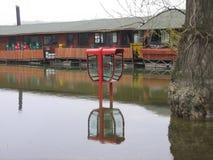 Cabine de telefone inundada Fotografia de Stock Royalty Free