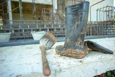 Cabine e zappa di gomma sporche del primo piano con il rinforzo vago s fotografia stock