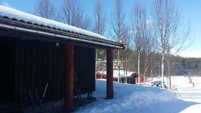 Cabine en hiver Photos libres de droits