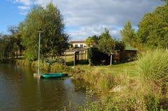 Cabine na borda de uma lagoa Imagem de Stock Royalty Free