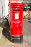 Cabine téléphonique rouge avec la citation de Shakespeare Image libre de droits