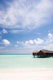 Cabines tropicais na água Fotografia de Stock Royalty Free