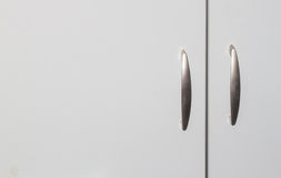 Cabinet doors. Grey cabinet doors with two handles can be used as background Royalty Free Stock Photo