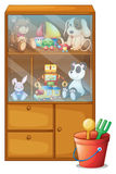 A cabinet full of toys Royalty Free Stock Images