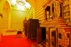 Cabinet and furniture inside Buddhist hall Royalty Free Stock Photos
