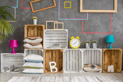 Cabinet made of wooden boxes stock image