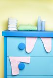 Cabinet in nursery room. Ready for newborn baby Stock Photos