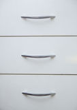 Cabinet with sliding trays and chrome handles Royalty Free Stock Photos