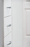 Cabinet with sliding trays and chrome handles Royalty Free Stock Photography