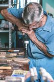 Cabinetmaker drilling wood in workbench Stock Image