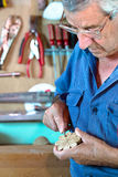 Cabinetmaker sanding a decorative piece of wood Royalty Free Stock Photos