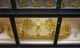 Racks with gold and silver and imitators dishes in the Imperial Silver Collection in the Hofburg. Cabinets with kitchenware in the Imperial Silver Collection in stock image