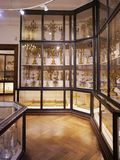 Shelving with goldware, which was used by the Habsburg emperors in the Imperial Silver Collection in the Hofburg. Cabinets with kitchenware in the Imperial royalty free stock photo