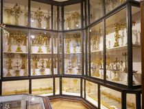 Shelving with goldware, which was used by the Habsburg emperors in the Imperial Silver Collection in the Hofburg. Cabinets with kitchenware in the Imperial royalty free stock photography