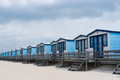Cabins on the beach. Blue cabanas for rent on a sandy beach Stock Images