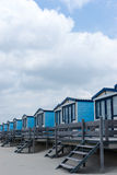 Cabins on the beach. Blue cabanas for rent on a sandy beach Royalty Free Stock Photography
