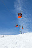 Cabins of cable car against blue sky Royalty Free Stock Images
