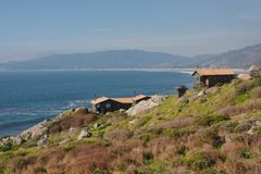 Cabins on the cliff. Cabins by the Pacific Ocean Stock Photography