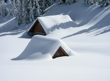 Cabins covered in snow