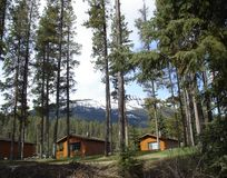 Cabins in the forest and mountains. Cozy cabins for a week-end retreat Stock Images