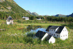 Cabins and houses  mirroring in Lofoten's lake Stock Photo