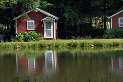 Cabins by the lake. Old Style family camping is still available between Galeton and Couldersport, Pennsylvania. This byway has the same red and white, wooden royalty free stock photos