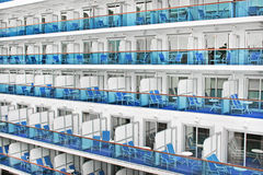 Cabins of a modern cruise ship. With blue chairs and balconies stock photography