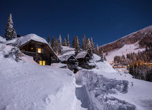 Cabins. In the mountains a winter night Stock Images