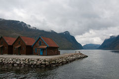 Cabins on shore at fjord. The horizontal picture of the tradinional norwegian cabins on shore at Frafjord royalty free stock photo